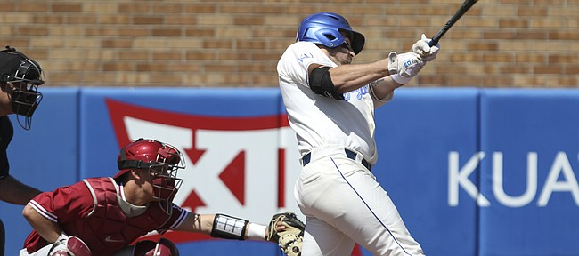 Kansas batter Ryan Pidhaichuk comes around on a pitch for a two-run double during the fourth inning against Oklahoma on Saturday, April 30, 2016 at Hoglund Ballpark.