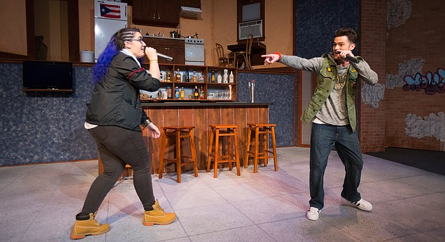 DJs, Nelson Cardenal, played by Bronwen Capshaw, left, and Trip Goldstein, played by Nathan Kruckenberg rap during a dress rehearsal for Welcome to Arroyo's, Wednesday in the William Inge Memorial Theater at Murphy Hall.