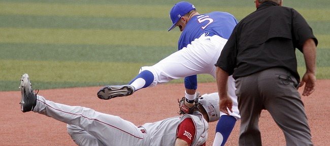 Kansas University shortstop Matt McLaughlin (5) tags out an Oklahoma runner in the Jayhawks' game Sunday, May 1, 2016, against the Sooners at KU.