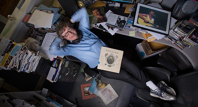 West Side Folk founder and artistic director Bob McWilliams is pictured in his office at the Kansas Public Radio studios. The show is ending its 20-plus year run this month.