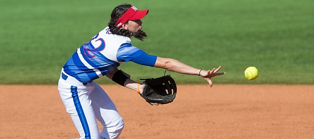 Kansas University junior Taylor McElhaney (32) makes a throw to first base for an out in the first inning  as KU hosted Iowa State Thursday at Arrocha Ballpark.