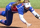 KU senior shortstop Chaley Brickey just misses a hard-hit ground ball in a doubleheader against Iowa State on Saturday, May 14, 2016, at Arrocha Ballpark.