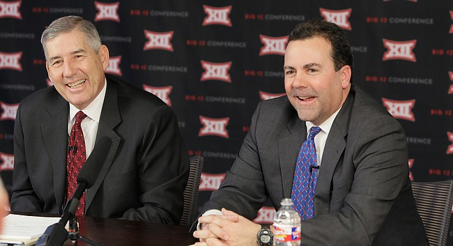 Big 12 commissioner Bob Bowlsby, left, and Kansas athletic director Sheahon Zenger laugh while taking reporters' questions after the first day of the conference's meeting Thursday, Feb. 4, 2016, in Irving, Texas. (AP Photo/LM Otero)