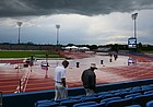 Two meet officials walk the stadium surveying water left on the field and debris thrown about after severe weather interrupted the NCAA Track and Field West Regionals on Thursday, May 26, 2016 at Rock Chalk Park in Lawrence, Kan. (AP PHOTO/Nick Krug/Lawrence Journal-World)
