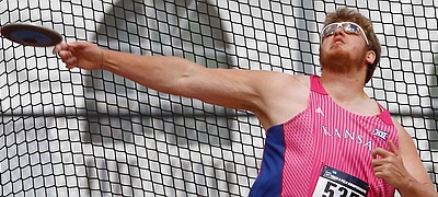 Kansas discus thrower Mitch Cooper competes Saturday, May 28, 2016, in the NCAA West Preliminaries track and field meet at Rock Chalk Park.