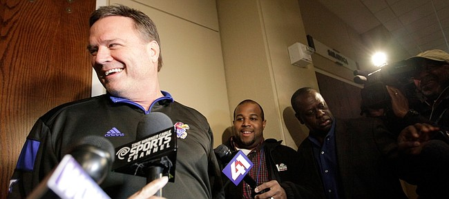 Kansas coach Bill Self talks to members of the media at the Hyatt Regency Downtown hotel where the Jayhawks arrived in Louisville, Ky. last March at the site of the NCAA South Regional.