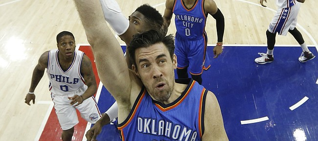 Oklahoma City Thunder's Nick Collison puts up a shot against the 76ers in this photo from March 18 in Philadelphia. Collison says he plans to return for his 14th season in the league.