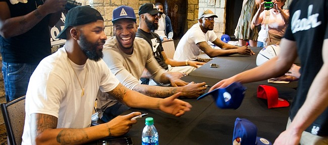 From left, Markieff Morris jokes with Thomas Robinson, as they, Marcus Morris and Mario Little all autographed FOE merchandise at the Oread Hotel Saturday afternoon. To check out the FOE gear, go to: http://www.foeinc.net/images