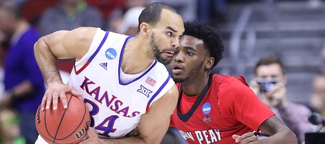 Kansas forward Perry Ellis (34) looks to make a move against Austin Peay forward Kenny Jones (42) during the first half, Thursday, March 17, 2016 at Wells Fargo Arena in Des Moines, Iowa.