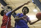 Blue Team guard Josh Jackson scoops a shot under Red Team guard Devonte Graham during the Bill Self basketball camp alumni scrimmage, Wednesday, June 8, 2016 at the Horejsi Athletic Center.