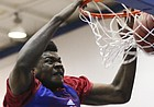 Freshman center Udoka Azubuike delivers a powerful dunk during a KU camp scrimmage on Wednesday, June 15, 2016 at the Horejsi Athletic Center.