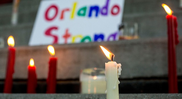 """The steps of the South Park gazebo are are lined with candles and a sign that reads, """"Orlando Strong,"""" during a vigil Sunday, June 12, 2016, in South Park. About two dozen people showed up to the vigil to show their support for the victims of the Orlando shooting."""