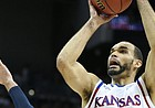 Kansas forward Perry Ellis (34) gets up for a shot over Villanova guard Ryan Arcidiacono (15) during the first half, Saturday, March 26, 2016 at KFC Yum! Center in Louisville, Kentucky.