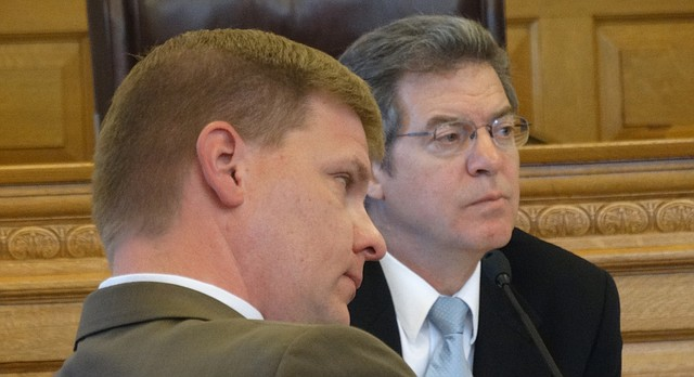 In this file photo from Aug. 24, 2015, Gov. Sam Brownback, right, and his budget director Shawn Sullivan listen to school officials make a case for additional funding.