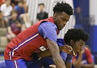 Red Team guard Lagerald Vick and Blue Team guard Josh Jackson compete for a loose ball during the Bill Self basketball camp alumni scrimmage, Wednesday, June 8, 2016 at the Horejsi Athletic Center.