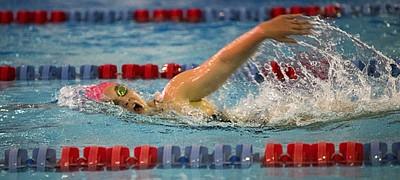 Kansas University freshman Libby Walker catches a breath during the 1,000-yard freestyle on Friday, Oct. 23, 2015, at Robinson Natatorium.