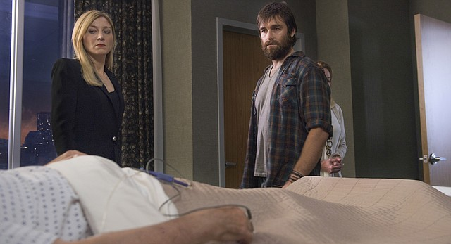 """Siblings Alison (Juliet Rylance) and Garrett (Antony Starr) grapple with the possibility that their recently deceased father — and patriarch of their affluent Boston clan — may have been the serial killer behind a string of grisly murders in CBS' """"American Gothic."""" The show's executive producer, Corinne Brinkerhoff, is a Lawrence native and 1998 graduate of Lawrence High School."""