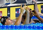 Michael Andrew reacts after winning his preliminary heat in the men's 100-meter breaststroke at the U.S. Olympic swimming trials, Sunday, June 26, 2016, in Omaha, Neb. (AP Photo/Mark J. Terrill)
