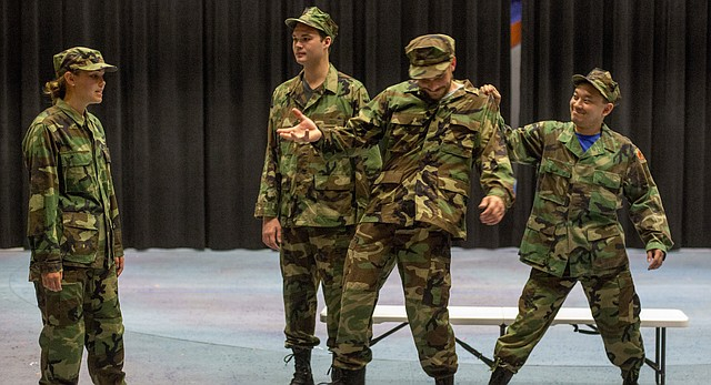 From left, Lindsey Fry, Corey Allen, Scott Olcott and Thomas Tong rehearse a scene from April in Iraq on Thursday, June 30, 2016 at Theater Lawrence.