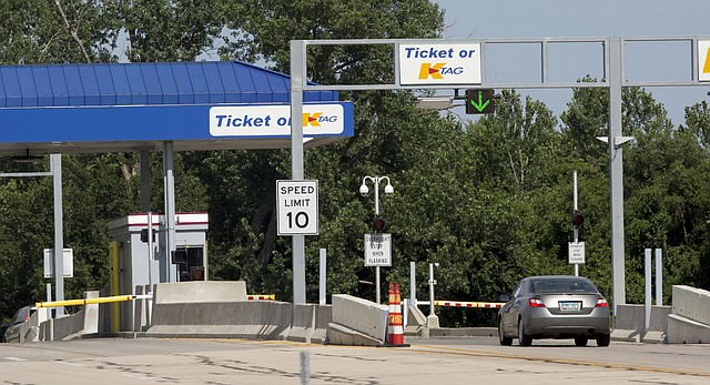 The Kansas Turnpike Authority will be getting rid of the gates to some K-Tag entrances, like this one at the eastern Lawrence entrance, and installing video cameras to monitor the lanes' traffic.