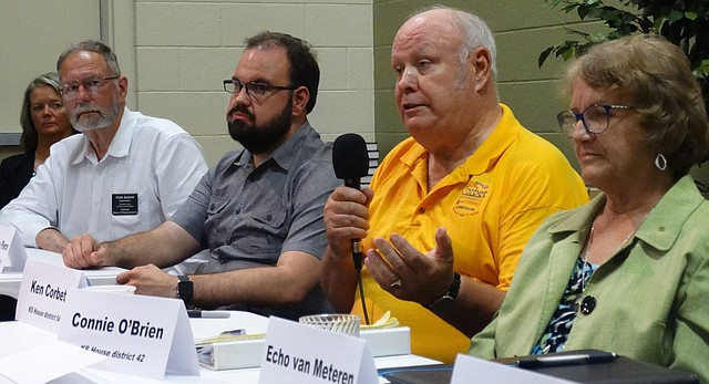 Rep. Ken Corbet of Topeka, answers questions during a GOP candidates forum Tuesday night sponsored by the Douglas County Republican Party. Rep. Tom Sloan of Lawrence, left, his challenger Jeremy Pierce, and Rep. Connie O'Brien of Tonganoxie, right, were among the other candidates participating.