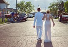 A Wellsville High School couple heads to the high school for their senior prom after promenading down Main Street for family and friends April 16, 2016.