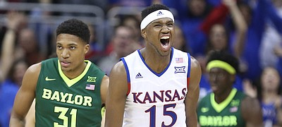 Kansas forward Carlton Bragg Jr. (15) celebrates after finishing a lob jam next to Baylor forward Terry Maston (31) during the second half, Friday, March 11, 2016 at Sprint Center in Kansas City, Mo.