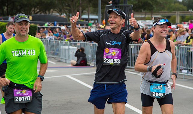 Jeff Galloway, center, gives a thumbs-up as he passes through the finish line at the Walt Disney World Marathon on Jan 10, 2016.
