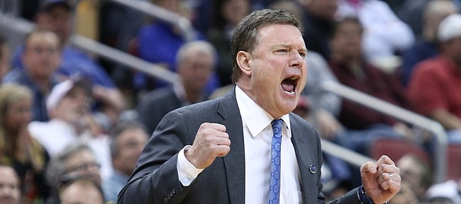 Kansas coach Bill Self yells in the second-half of the Jayhawks 79-63 win over the Maryland Terrapins Thursday, March 24, 2016 in an NCAA Sweet Sixteen matchup at KFC YUM! Center in Louisville, KY.