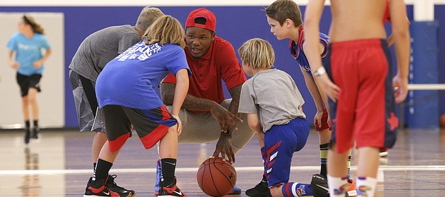 Ben McLemore gets down with some of the campers to talk strategy during his and Andrew Wiggins' Kansas All-Star Basketball Camp on Wednesday, July 13, 2016 at Sports Pavilion Lawrence.