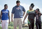 From left, Kansas University products Kyle Clemons, Mason Finley, Daina Levy, and Zainab Sanni walk the track on Wednesday, July 13, 2016, at Rock Chalk Park. The four are headed to the Rio Olympics.
