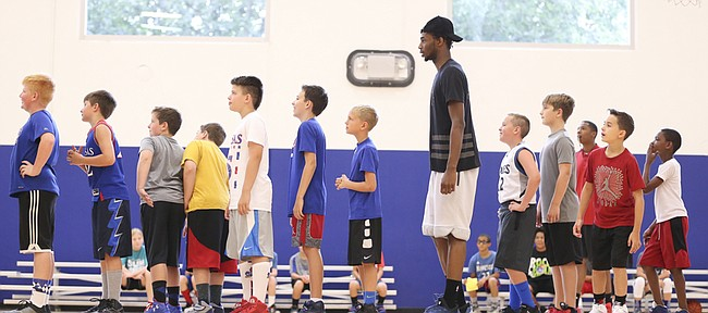 Minnesota Timberwolves guard and former Kansas star Andrew Wiggins waits in line with the campers for his turn to shoot during his and Ben McLemore's Kansas All-Star Basketball Camp on Thursday, July 14, 2016 at Sports Pavilion Lawrence.