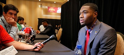 Kansas University quarterback Montell Cozart responds to questions during Big 12 college football media days, Monday in Dallas.