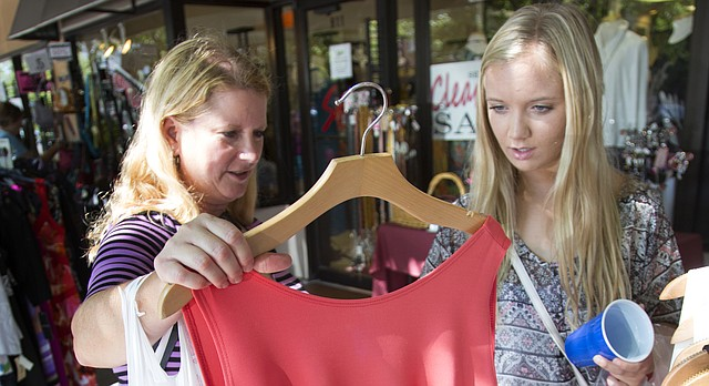 From left, Katie Burenheide and her daughter Brianna, both of Lawrence, hit the Sidewalk Sale early on Thursday, July 21, 2016, in downtown Lawrence.