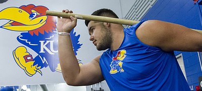 Kansas University football center Joe Gibson works out with the team Friday, July 15, at the Anderson Family Football Complex.