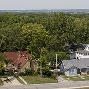 This view from Memorial Stadium, over district 1 of the Oread neighborhood, shows a portion of Fambrough Drive at bottom and the neighborhood to the north. Landlords in the Oread neighborhood are disgruntled about some new, years-in-the-making design guidelines that passed the city's planning commission July 25 and will next go to the city commission for final consideration.