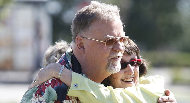 Chuck Berg, a longtime professor of film and media studies at Kansas University, hugs Mary Doveton, executive director of Theatre Lawrence, at a groundbreaking for the new Theatre Lawrence building on Thursday, May 10, 2012. Berg died July 26 at Lawrence Memorial Hospital at age 75.