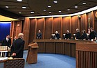 Kansas Supreme Court Justices take their seats to hear oral arguments in this file photo from Dec. 10, 2015.