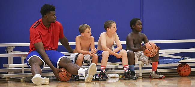 Kansas center Udoke Azubuike sits with skins team players Alec Sievert, left, Brady Johnson and Andrew Nelson during Ben McLemore and Andrew Wiggins' Kansas All-Star Basketball Camp on Wednesday, July 13, 2016 at Sports Pavilion Lawrence.