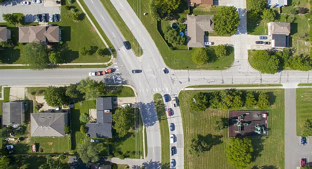 Vehicles pass through the intersection of Harvard Road, left to right, and Kasold Drive, pictured Tuesday, Aug. 9, 2016.
