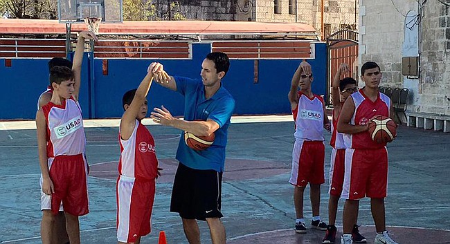 Former Kansas Guard Brett Ballard, center, instructs young players in late July as part of the PeacePlayers International initiative in Israel. Ballard, who is an assistant coach at Wake Forest, spent a week helping at coaching clinics in the region.