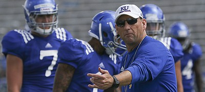Kansas football coach David Beaty gives out instruction during a drill in KU's Fan Appreciation Day practice on Saturday, August 20th at Memorial Stadium.