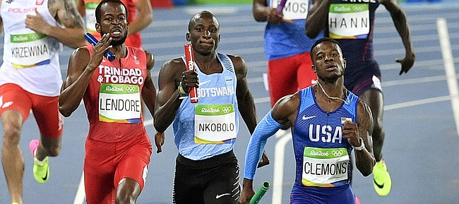 United States' Kyle Clemons, right, competes in a men's 4x400-meter relay heat during the athletics competitions of the 2016 Summer Olympics at the Olympic stadium in Rio de Janeiro, Brazil, Friday, Aug. 19, 2016. (AP Photo/Martin Meissner)