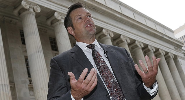 Kansas Secretary of State Kris Kobach responds to questions outside the 10th U.S. Circuit Court of Appeals after delivering an argument in the legal fight over how the state of Kansas enforces its proof-of-citizenship requirement for voters who register at motor vehicle offices on Tuesday, Aug. 23, 2016 in Denver.