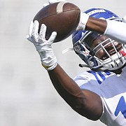 Kansas freshman cornerback Kyle Mayberry pulls in a catch during practice on Friday, Aug. 19, 2016 at Memorial Stadium.