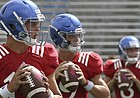 Kansas quarterbacks, from left to right, Ryan Willis, Carter Stanley and Keaton Perry warm up for KU's fan appreciation day practice on Saturday, August 20th at Memorial Stadium.