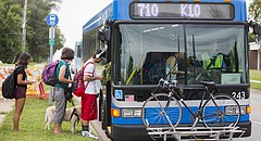 Bus riders heading to Johnson County Community College get on the K-10 Connector at the 19th Street and Haskell Avenue pickup spot on Tuesday, Aug. 30, 2016.