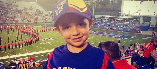 Cole Hayden attends a Kansas football home game in 2015, before being diagnosed with undifferentiated sarcoma.