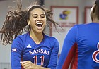 Kansas setter Ainise Havili celebrates a point from teammate Kelsie Payne against Chicago State during the first set on Friday, Sept. 2, 2016 at the Horejsi Family Athletic Center.