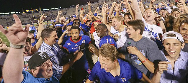 Kansas wide receivers LaQuvionte Gonzalez (1) and Steven Sims Jr. (11) are surrounded by fans during a postgame interview following the Jayhawks' 55-6 win over Rhode Island on Saturday, Sept. 3, 2016 at Memorial Stadium.
